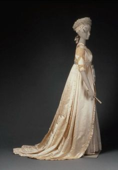 Silk- and metallic-embroidered silk satin wedding dress with silver-embroidered cotton mull petticoat, American, c. 1799. Worn by Eunice Hooper at her wedding to her cousin John Hooper, in Marblehead, Massachusetts.