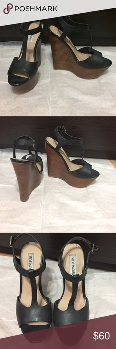 Steve Madden Wedges Simple black wedges with a wood color heel. The heel heigh is 4 inches along with a 1.5 inch platform. Steve Madden Shoes Wedges