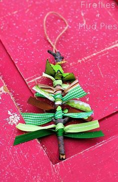 Create a rustic tree ornament from sticks and ribbon scraps.