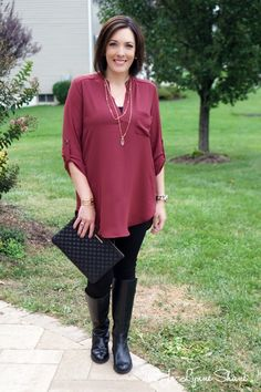 Burgundy Top with Black Leggings and Gold Accessories   I like this top with a layered necklace — something shorter to fill the neckline and something longer to break up the expanse of burgundy. Longer tops tend to look best with a long necklace.
