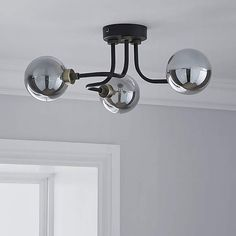 Designed with three black curved arms, this ceiling light fitting features three shiny glass spheres which change colour when the light is switched on. Modern Bedroom Ceiling Lights, Light Fixtures Bedroom Ceiling, Kitchen Ceiling Lights, Black Ceiling, Modern Hallway, Hallway Lighting, Ceiling Lighting, Black Curves, My Home Design