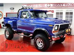 blue lifted Ford truck