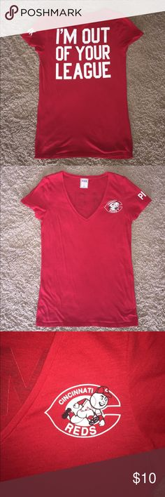 """Victoria's Secret PINK, Cincinnati Reds Shirt This shirt features the old school Cincinnati Reds logo on the left side of the chest. The back of the shirt reads """"I'm out of your league."""" Color is red, size is large. This shirt is well worn, but in great shape for a PINK t-shirt. PINK Victoria's Secret Tops Tees - Short Sleeve"""