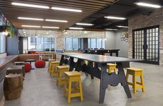 Lightspeed Research wanted their Sydney office to feel like a home away from home for their staff, and the relaxed, whimsical space designed by The Bold Collective certainly achieves this. A pool room contains homely features such as a fake moose-head and framed pictures of staff participating in sporting activities, while the large communal desk sits beside a table-tennis set.