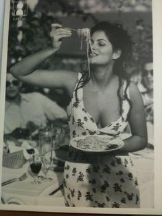 An Italian beauty enjoying her spaghetti!  How we adore her!
