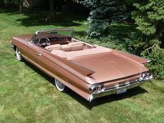 1961 Cadillac - Yep! I owned this model, same color, as well. Went from this to my 64 Mustang convertible.