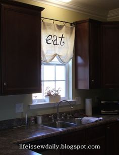 Drop Cloth Curtains.  Maybe using a tension rod and doing this in the kitchen. OR,,,,,,, doing this part way down on my tall windows in the front room?