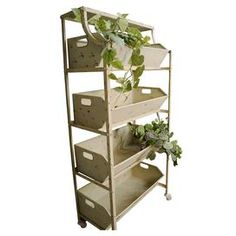 Metal display rack with four bins.  Product: Display rackConstruction Material: MetalColor: CreamDimensions: 60.25 H x 29.5 W x 20 D Note: Plants not includedCleaning and Care: Dust with dry cloth