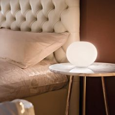 A glowing ball of light, the Glo-Ball Basic Table Lamp from FLOS Lighting provides an ambient layer to modern bedroom lighting.…