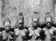 Africa   Four young Mende women, initiated into the Sande society, wearing traditional hairstyles that bare resemblance to those depicted on many Sowei masks. Vassa Country, probably Yandahu, Upper Mendi . ca 1891 - 1901. Photographer Thomas Joshua Alldridge    Photographic print from the Brighton Museum and Art Gallery