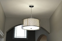 foyer light/ This is similar to the one you have we could use it in your foyer.. It would look similar to this.