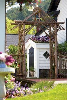 """I would name this a """"Carpenter Gothic"""" arbor, due to the design and craftsmanship involved. It appears to be permanently installed. An arbor similar to this, made of driftwood, could be used for a wedding and afterwards, installed in the garden of the newlyweds.  That would be some present!"""