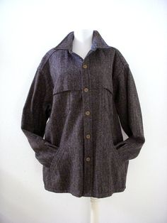 Great wool shirt jacket from Woolrich in a rich gray herringbone tweed with just a hint of red. It features an attached cape-ish piece on both