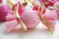 Favor packaging idea. Instant upgrade: Wrap store-bought candies in crepe paper. Here, Lindt chocolates are wrapped in crepe paper which is taped close (double-sided) with two quick ribbon ties. via such pretty things