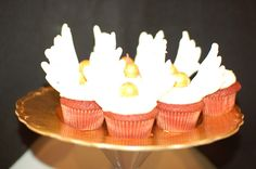 Smarty Parties: Golden Snitch cupcakes: gold gumballs, white candy melts piped into the shape of wings and stuck into the icing.