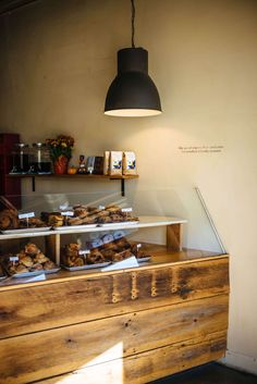 Visit Bolted Bread in Raleigh has the best bread and selection of pastries, The Taste SF Shop Interiors, Best Places To Eat, Decorative Items, Liquor Cabinet, The Good Place, Traveling By Yourself, Tub, Bakery, Interior Shop