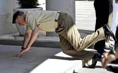 Spanish King Juan Carlos stumbles and falls to the ground during his visit to the Spanish Armed Forces Staff headquarters in Madrid, Spain, ...