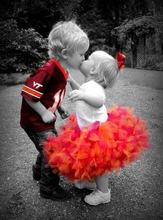 Sweet Angels...I love this photo, the way they only left the bright colors. And you know that is just a baby kiss, so it is adorable.