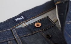Pre-Orders now open! Ship date of this Small Batch will be on May 18. The Truman is a mid-rise, regular fit jean with room to breathe through the thigh and slightly tapered from the knee down. Our most popular fit, the Truman Regular is a classic jean made for any guy.This small batch production features a vintage indigo dyed selvage denim, which has almost a grey cast to it. It is starchy and shiny at first but softens up quickly. It is finished with our Kentucky made raw copper…
