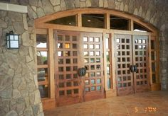 DbyD-6002.  These massive 10 ft. doors were custom designed and built of Mesquite wood for The Gaylord Opryland Resort and Convention Center of Texas.  Mesquite wood was chosen because it is native to Texas.  Finding the wood to build doors this size was a real challenge since Mesquite is closer to a bush than a tree!  You can see these doors in Grapevine, Texas.  Grapevine is a suburb of Dallas.