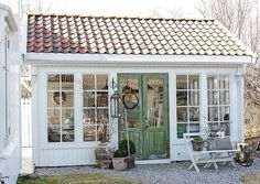 Pretty and rustic greenhouse or shedquarters!