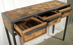 Platform style console table with 3 drawers made from reclaimed outrigger canoe fishing boat wood and steel.