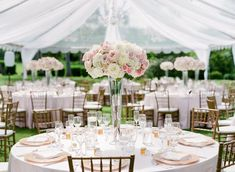 Tall Flower Centerpieces Create Dramatic Elegance at Round Wedding Tablescapes by Moana Events