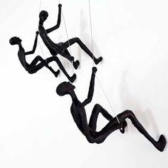 climbing-man-wall-sculpture-set-of-3-sculptures-black