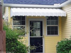 Take a look at this great fabric awning - what an inventive concept Awning Over Door, Porch Awning, Diy Awning, Front Porch, Front Doors, Fabric Awning, Porch Roof, Garage Doors, Aluminum Window Awnings