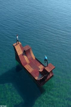 Sk8rs on a half pipe on the water