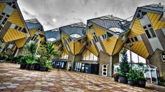 "The late Dutch architect Piet Blom designed these whimsical <a href=""http://www.kubuswoning.nl/introkubus2.html"" target=""_blank"">cubic houses</a> in Rotterdam and Helmond, in the Netherlands. The top part of the homes are tilted 45 degrees to create a dizzying effect."