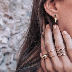 Gold Details  Arrow Earrings Black ➕ Dome Ring, Twist Ring x2 & Triple Ring ❤️ Want them? Shop now  www.maria-pascual.com #mariapascual #mariapascualearrings #mariapascualrings #gold #jewelry #joyas #joyitas #lifestyle #outfit #ootd #cute #shooting