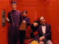 Madame D (Tilda Swinton) lays her head on M. Gustave's (Ralph Fiennes) shoulder as they take a colorful elevator ride down The Grand Budapest Hotel: http://www.dvdizzy.com/grandbudapesthotel.html