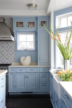 Geometric-patterned tile backsplashes send these 26 stylish kitchens to the next level of dynamic design. Get inspired to try a geometric kitchen backsplash in your own design., Think beyond subway tile. Interior Design Kitchen, Kitchen Decor, Blue Kitchen Ideas, Blue Country Kitchen, Rustic Kitchen, Küchen Design, House Design, Design Ideas, Blue Kitchen Cabinets