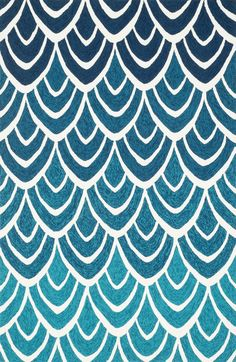 Half circle shapes group together to create a wave-like pattern, perfect for a child's room or seaside home.
