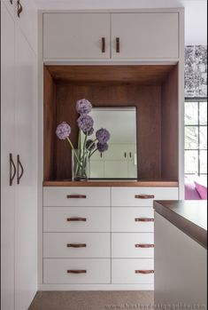 Hacin+Associates transformed a 1932 Tudor Revival into a modern family home with open interior, original details, sleek finishes & contemporary furnishings. Style Tudor, Tudor Style Homes, Tudor Kitchen, Dressing Room Design, Dressing Rooms, Laundy Room, Built In Dresser, Wood Detail, Custom Cabinetry