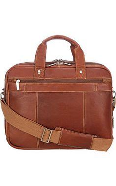 I have a bag VERY close to this one. Got it while working at Wilsons Outlet years ago. It is weathered now but still a great bag.