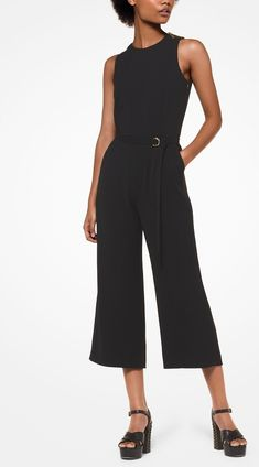 ff281ff754 Black Cady Belted Jumpsuit - This cady belted jumpsuit features a fitted  bodice that descends into
