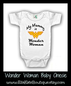 Know a Mom who is a Wonder Woman? Well then her little one needs this onesie.  Also available in t-shirts. Shop at www.EllaKateBoutique.etsy.com