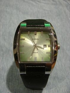 Used Square silver chronograph watch with black leather