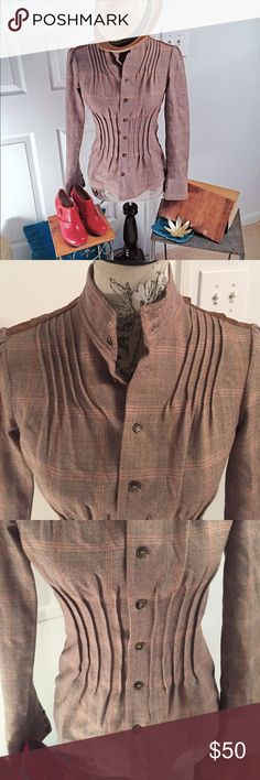Free People jacket size 4 Gorgeous vintage like Free People blazer in excellent condition with ruffled thin material at the back and part wool tweed at the front and sleeves.  The shoulders are tufted and there is gathering at the chest and waist making it form fitting and perfect for the upcoming fall weather. Free People Jackets & Coats Blazers