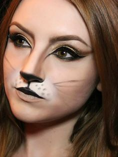 This cat makeup is my absolute favorite! Really great look for a family-friendly Halloween party.