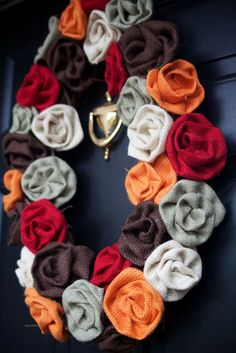 Love this burlap rosette wreath! #fall #wreath #burlap