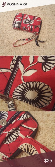 VERA BRADLEY Red White Floral Wallet w/ Pocket A cute little Vera Bradley wallet featuring a red and white floral pattern!  Includes a front pocket with snap closure for a cell phone.  The wallet can be secured to your purse or belt loop with the attached clip-on hardware. There are some scratches/scuffs on the hardware as well as some discoloration to the fabric in some spots (please refer to photos). Overall, though, this is in very good preowned condition. A perfect accessory for…