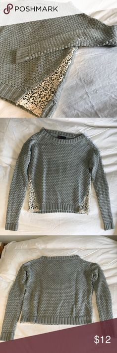Grey Cropped Sweater with Lace Cut Outs On trend fitted grey cropped sweater with lace cutout designs on both sides. Size small. Gently worn and in great condition! Sweaters
