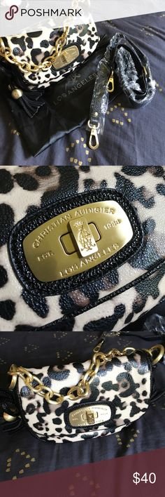 Brand new Christian Audigier handbag. BRAND NEW Christian Audigier cheetah print handbag. Never used. Beautiful heavy gold hardware! Longs strap included, still in the plastic. Dust bag also. Great size if you like a small bag or just want to use for date night!! ❤️❤️❤️MAKE AND OFFER!! 😁😁 Christian Audigier Bags Mini Bags