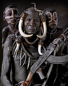 Hilao and his grand kids, part of the Mursi Tribe in Southern Ethiopia. Generations combine in painted harmony to consolidate the force of their unique heritage. #JimmyNelson #BeautyCouncil #DiscoverBeauty