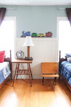 Boys' room with vintage desk as bedside table.