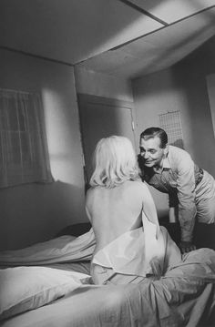 Marilyn Monroe with Clark Gable on the set of The Misfits, 1961, directed by John Huston. Photo by Inge Morath.
