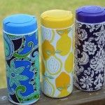 Lysol wipe containers revamped with fabric to use as a plastic bag dispenser... great idea!